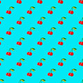 Two red cherries with leaves on blue background seamless pattern Royalty Free Stock Photo