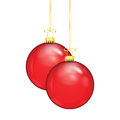 Two red christmas balls on a gold ribbon isolated white background Stock Images