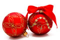Two red christmas balls with ribbon isolated on a white background Stock Photo