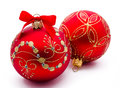Two red christmas balls with ribbon isolated on a white background Stock Photography