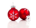 Two red christmas decoration balls on white background Royalty Free Stock Images