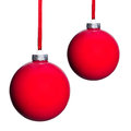 Two red christmas tree balls isolated before white background Royalty Free Stock Photos