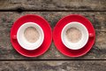 Two red cups with powdered coffee on old wood background top view pair of Stock Photos
