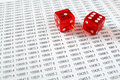 Two red dice on a spreadsheet. Royalty Free Stock Photo