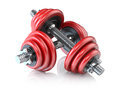 Two red dumbbells Royalty Free Stock Photography