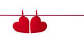Two Red Felt Hearts Hanging On...