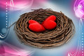 Two red heart in a bird nest attractive color background Stock Photo