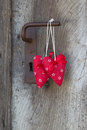 Two red heart shape hanging on door handle for valentine chris christmas wedding mother s day or anniversary greeting card Stock Photo