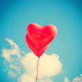 Two red heart shaped balloons over blue sky Royalty Free Stock Photography