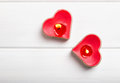 Two red heart shaped candles on the white table, Royalty Free Stock Photo