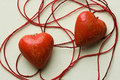 Two red heart shapes in cotton cobweb Stock Photography