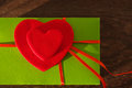 Two red hearts on a green background with a red tape Royalty Free Stock Photo