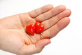 Two red hearts on man's hand on white background. Hearts on the palm Royalty Free Stock Photo