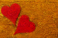 Two red hearts merged with an abstract wooden background Royalty Free Stock Photos