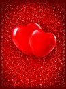 Two red hearts on red background. Stock Photos