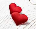 Two red hearts on white wood background Royalty Free Stock Images