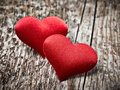 Two red hearts on wood background Royalty Free Stock Photo