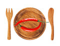 Two red hot chilli peppers on wooden background isolated on whit Royalty Free Stock Photo
