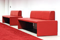 Two red sofas in a corridor Stock Photos