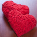 Two red thread hearts Royalty Free Stock Photography