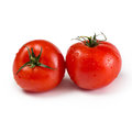 Two red tomatoes Royalty Free Stock Photo