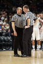 Two referees discuss a call during a game michigan and penn state Stock Images