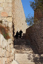 Two religious Jews lifted up the stone steps. Royalty Free Stock Photography
