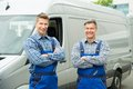 Two Repairmen With Arms Crossed In Front Of Van Royalty Free Stock Photo