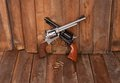 Two revolvers with bullets on a wooden background Royalty Free Stock Photo