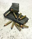 Two rifle mags with bullets on the floor Royalty Free Stock Photo