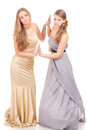 Two rival girls in gold and silver dress Stock Photo