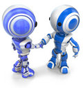 Two Robots Shaking Hands Stock Photo