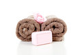 Two rolled towels and soap Stock Photos