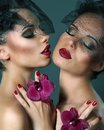 Two romantic females with violet flowers portrait of Royalty Free Stock Image