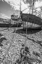 Two romantic old fishing boats wrecks Stock Photography