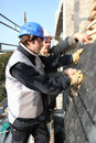 Two roofers are working together Stock Photo
