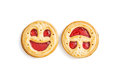 Two round biscuits smiling faces, humorous sweet food, isolated Royalty Free Stock Photo