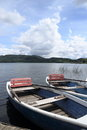 Two row boats at pier on lake Royalty Free Stock Photo