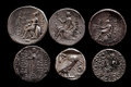 Two rows of ancient greek silver coins Royalty Free Stock Photo