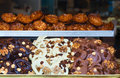 Two rows of belgian chocolate and cookies with nuts Royalty Free Stock Photo