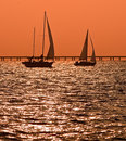 Two sailboats at dusk Stock Images