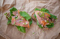 Two salmon sandwiches on a paper bag Royalty Free Stock Image