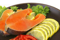 Two salmon steak on dark dish Royalty Free Stock Photo