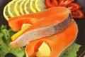 Two salmon steak on dark dish Royalty Free Stock Photo