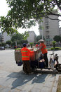 The two sanitation workers in guilin are picking up trash on street Royalty Free Stock Images