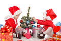 Two santa helpers decorating a tree Royalty Free Stock Photos