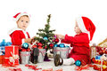 Two santa helpers decorating a tree Stock Image