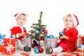 Two santa helpers decorating a tree Stock Photography