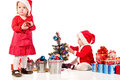 Two santa helpers santas girls decorating new year tree Stock Image