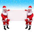 Two santa holding a big sign in iceland Royalty Free Stock Photo
